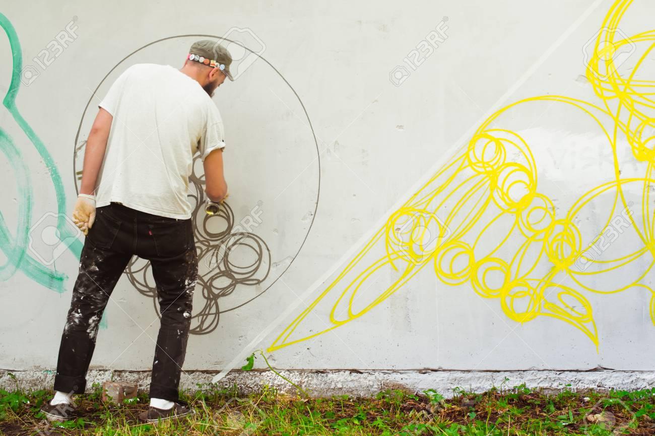 Graffiti on a fence. - 88298101