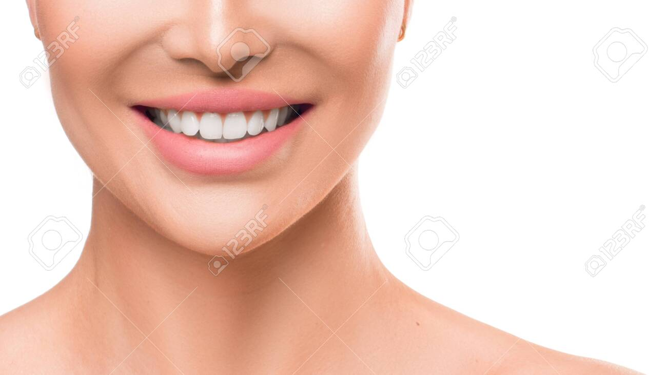 Close up photo of a woman smiling. Teeth whitening and dental health. - 130110771