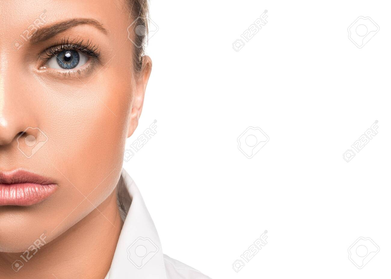 Close up portrait of a serious woman. Half of face and copy space. - 130111027