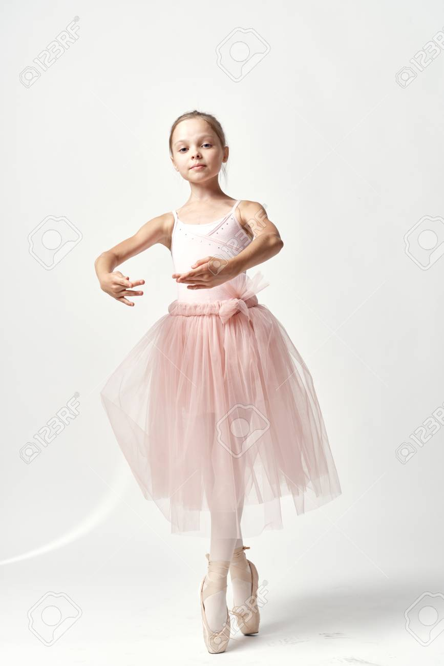 a ballerina wearing a pink color tutu stock photo picture and