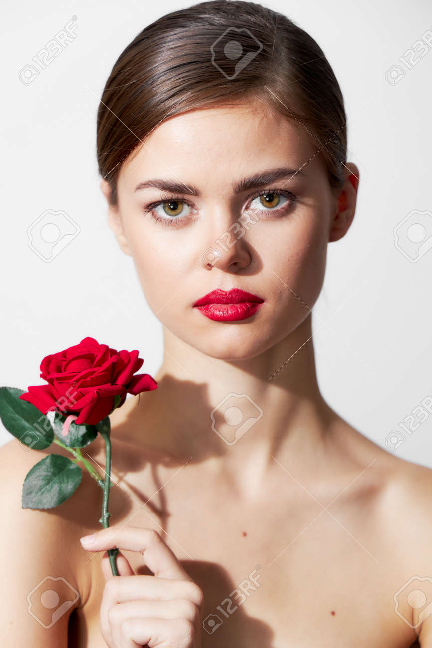 Woman with flower Bare shoulders are an attractive luxury look red lips - 155704702