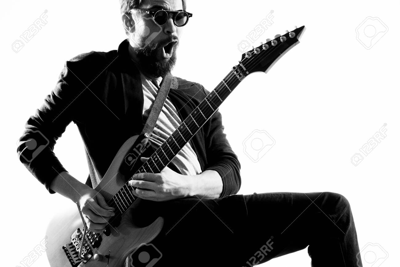 Male musician with guitar music rock star light background - 156735596