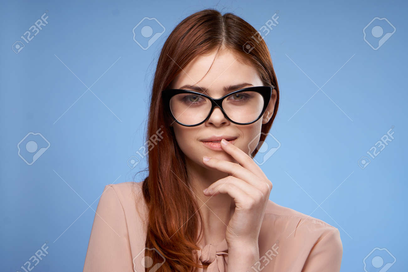 woman wearing glasses pink shirt elegant style attractiveness blue background - 164342646