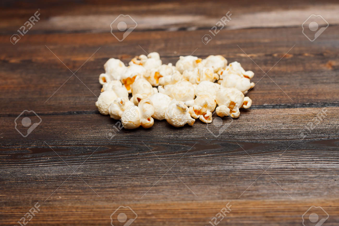 popcorn on a wooden table snack classic delicacy - 165457289