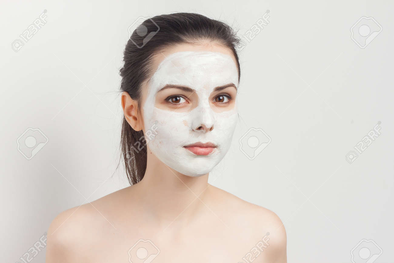 pretty brunette with cream face mask shoulders smile cropped view - 165807401
