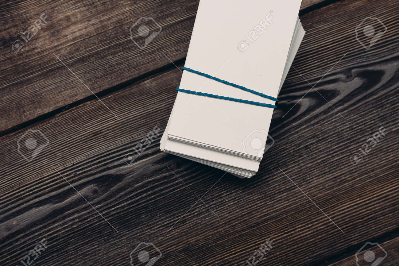 bundles of business cards on a wooden background top view work finance - 166379750