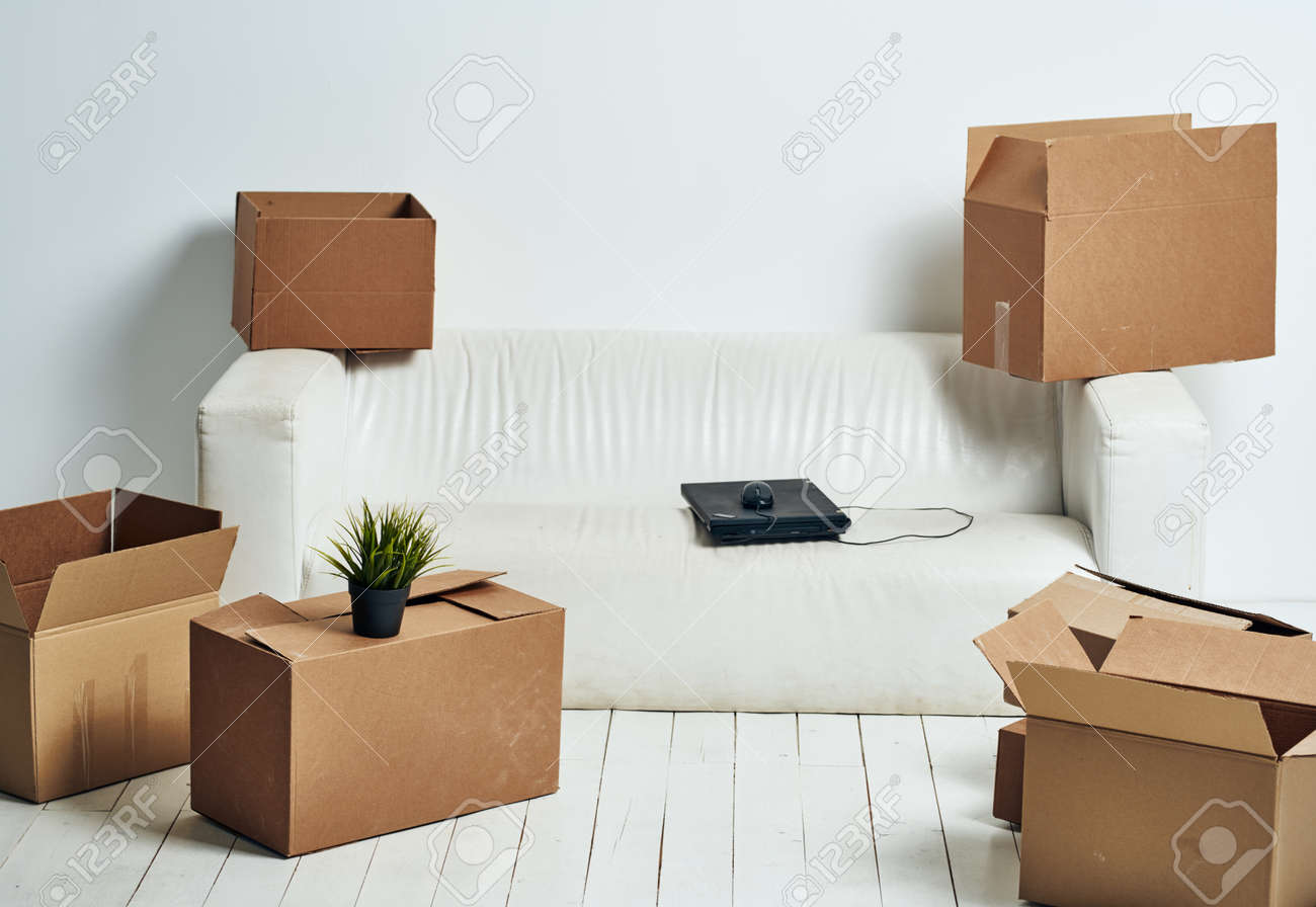 Boxes with things white sofa unpacking office moving - 166590492