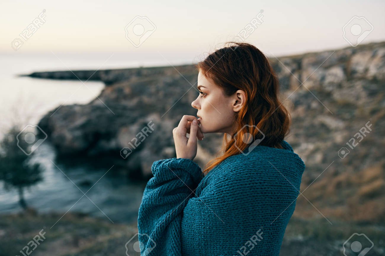 woman travels in the mountains on nature in the lake and blue plaid - 169385821