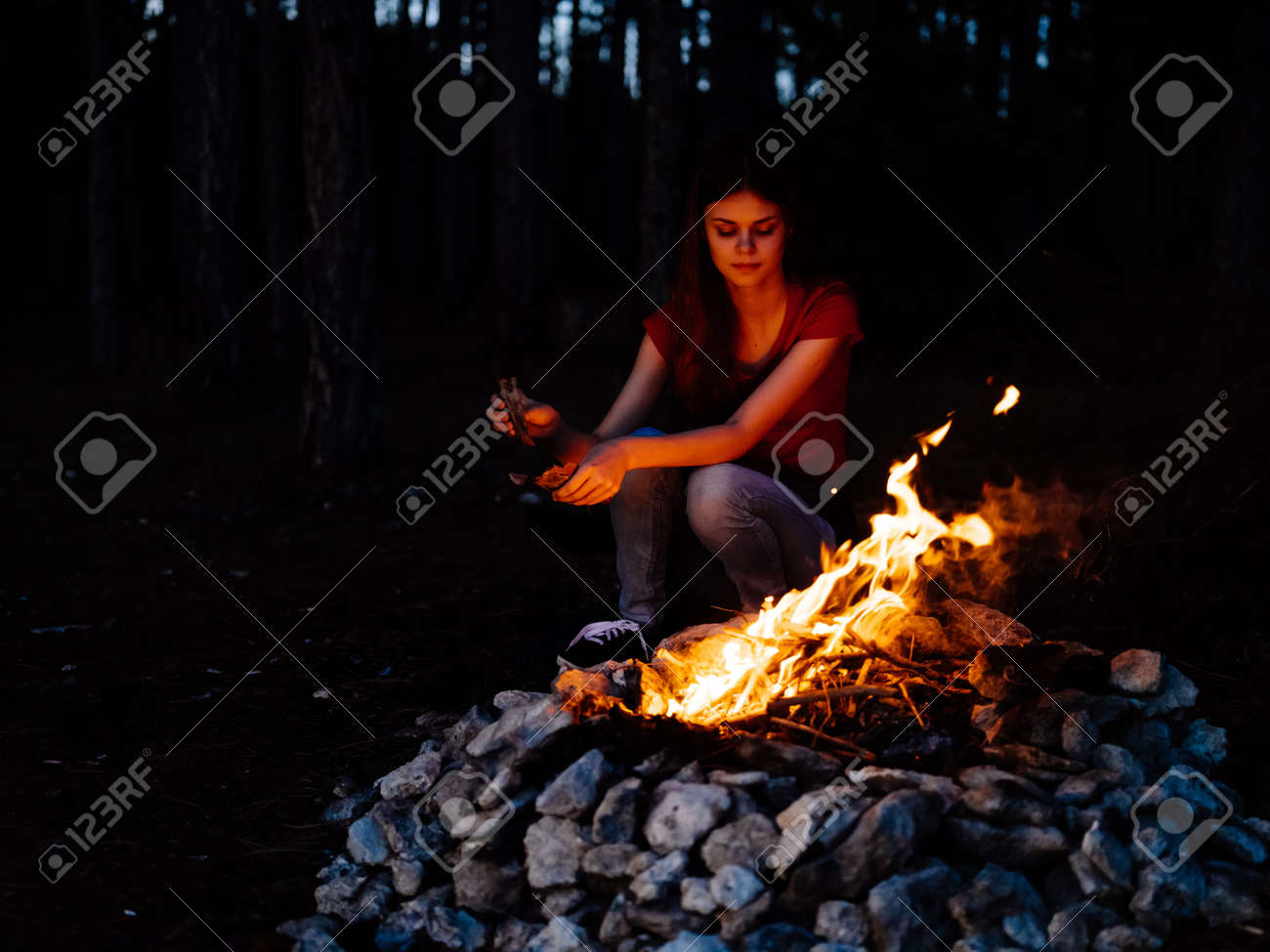 woman sitting in nature near the campfire rest forest - 171899898