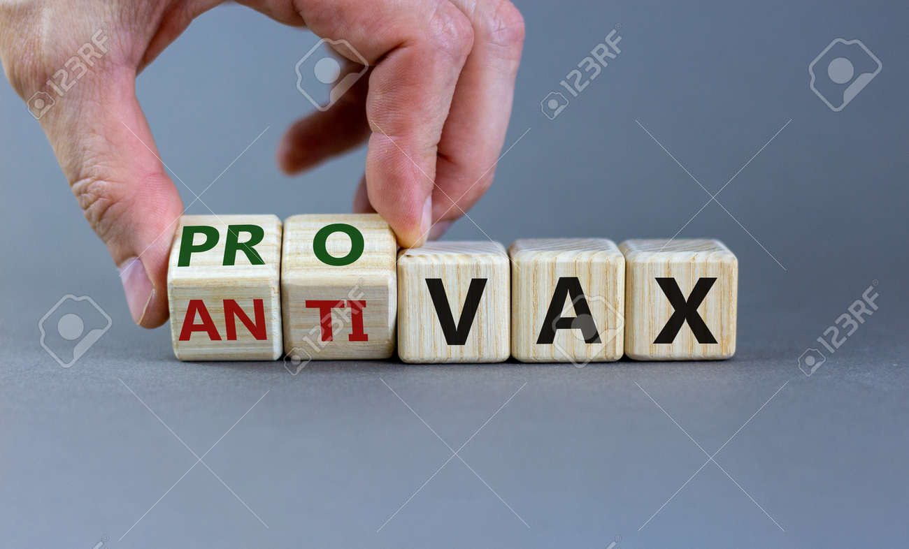 Pro-vax or anti-vax symbol. Doctor turns a cube, changes words 'anti-vax' to 'pro-vax'. - 164136648
