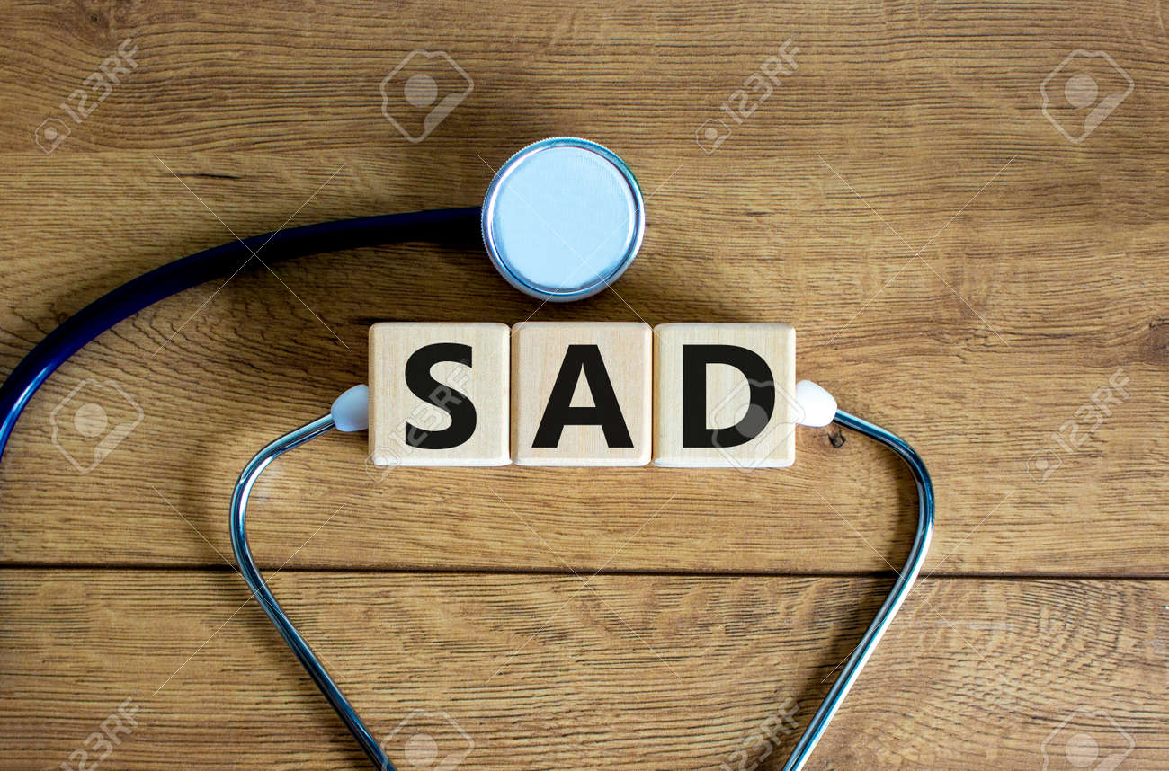 SAD, social anxiety disorder symbol. Concept words 'SAD, social anxiety disorder' on cubes on a beautiful wood background. Medical, psychological and SAD, social anxiety disorder concept. Copy space. - 166847544
