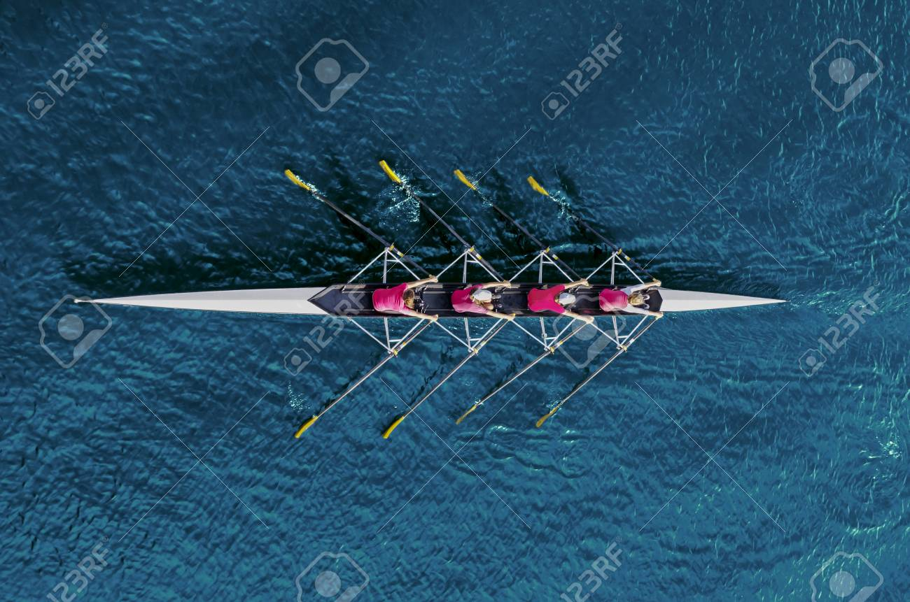Women's rowing team on blue water, top view - 93560697