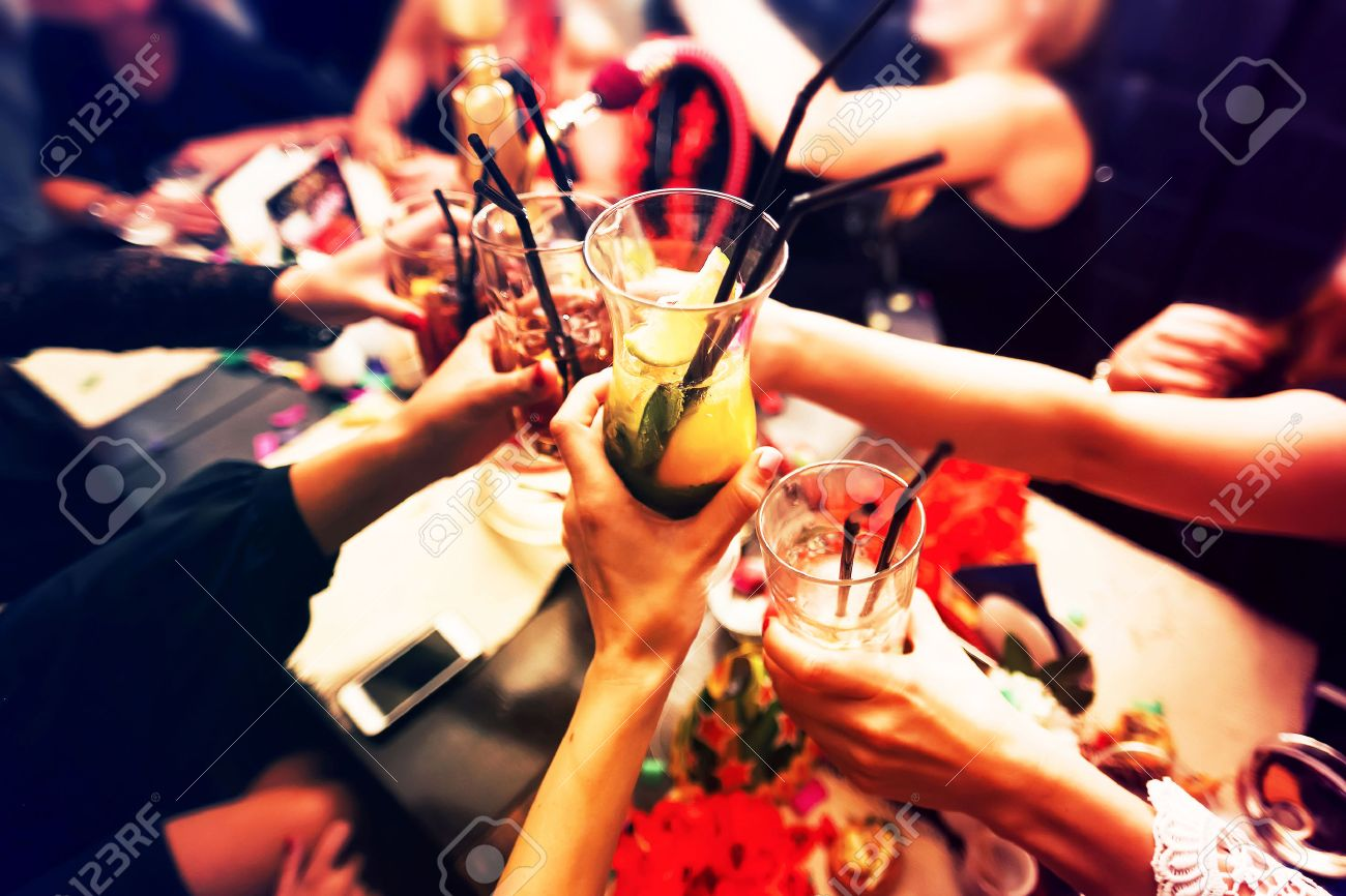 Clinking glasses with alcohol and toasting, party - 52473163