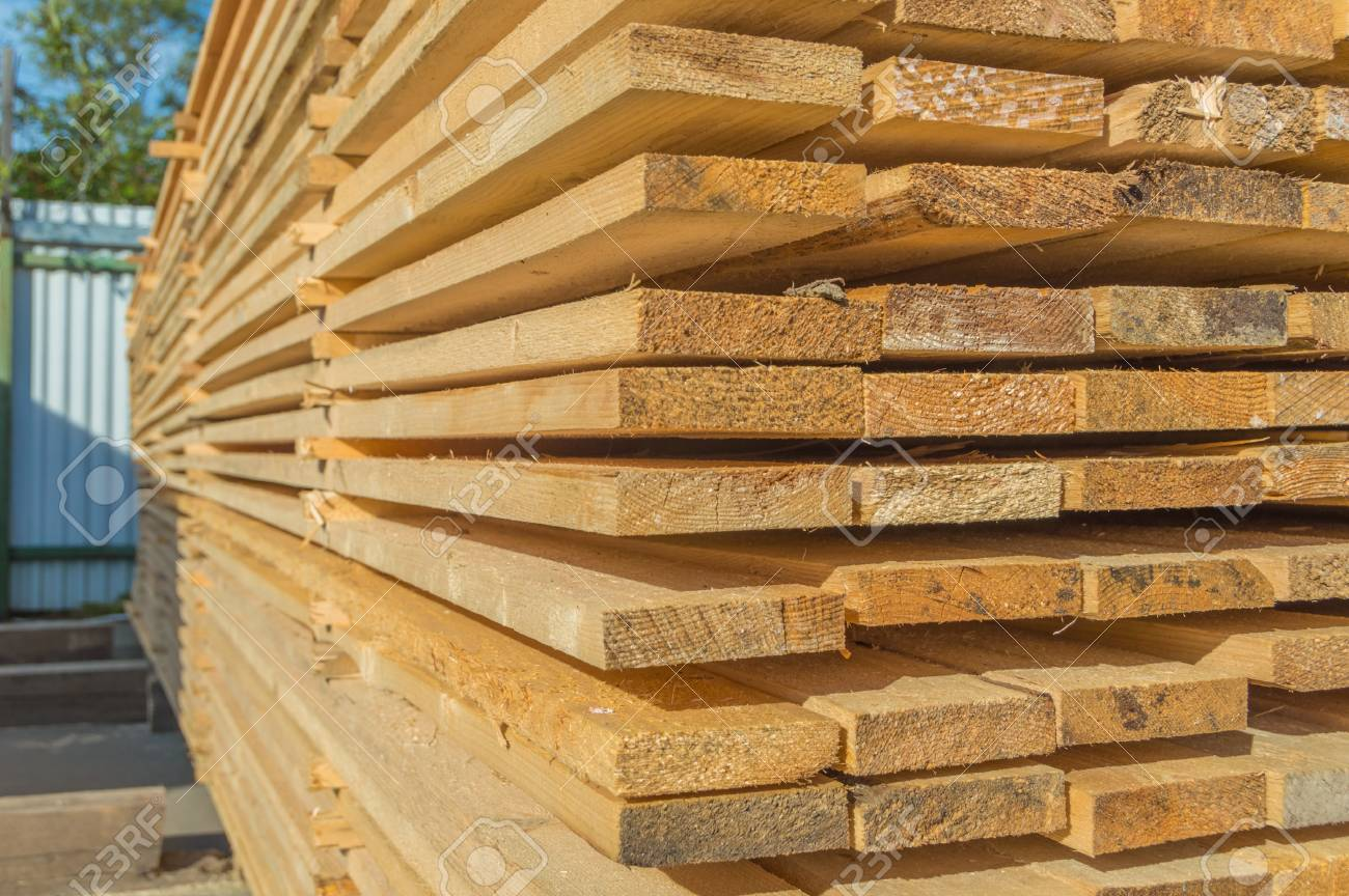 Warehouse of boards after sawing the outdoors. - 84933654