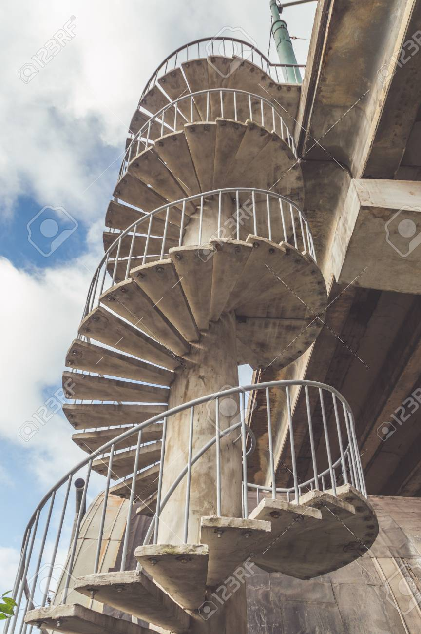on the street spiral staircase of concrete