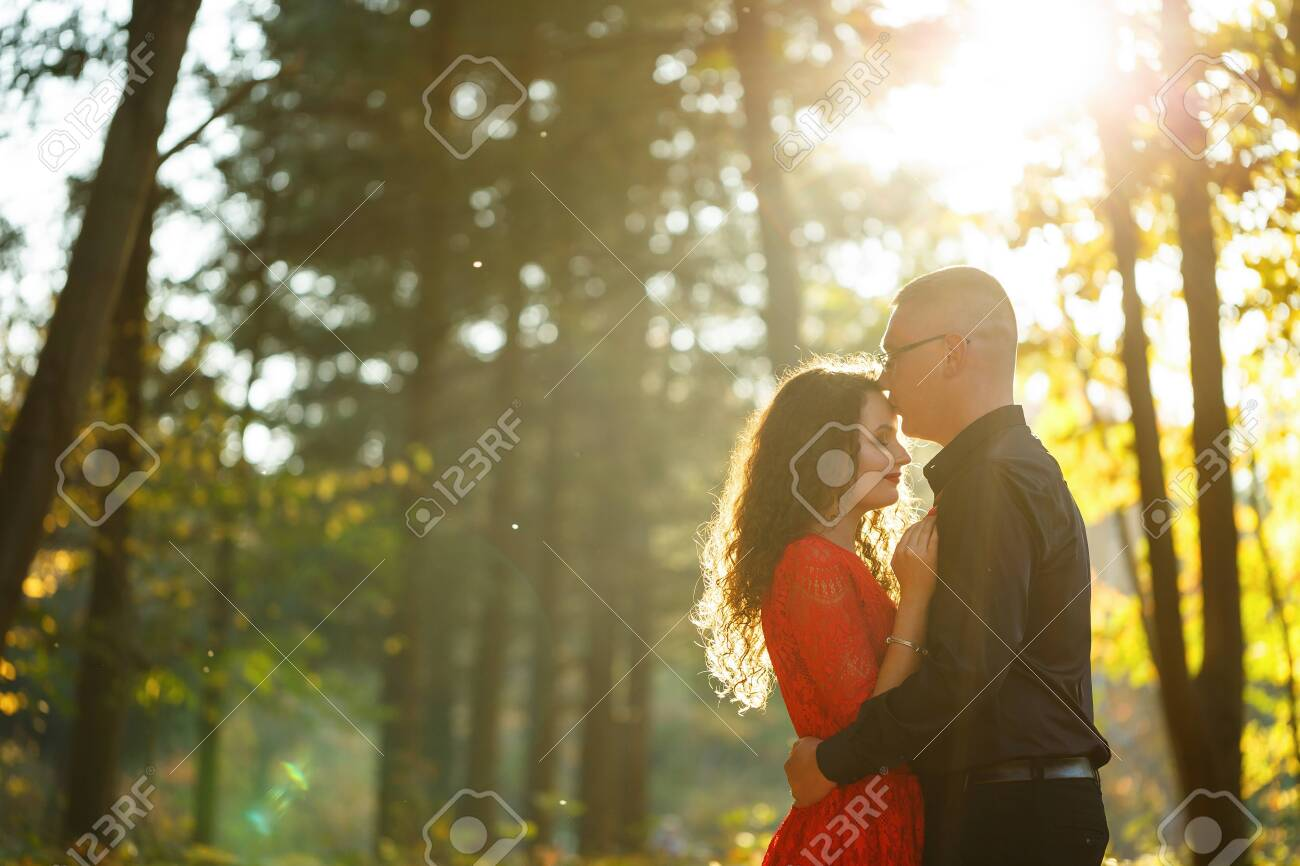 Beautiful couple in the autumn forest - 153487664