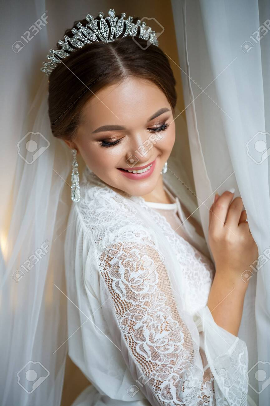 Beautiful Bride In A Wedding Morning In A Bathrobe And Veil Stock Photo Picture And Royalty Free Image Image 155766295