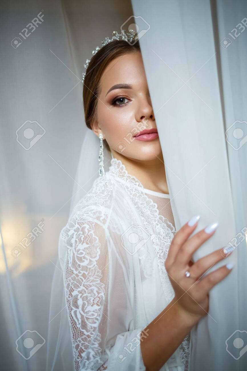 Beautiful Bride In A Wedding Morning In A Bathrobe And Veil Stock Photo Picture And Royalty Free Image Image 155766296