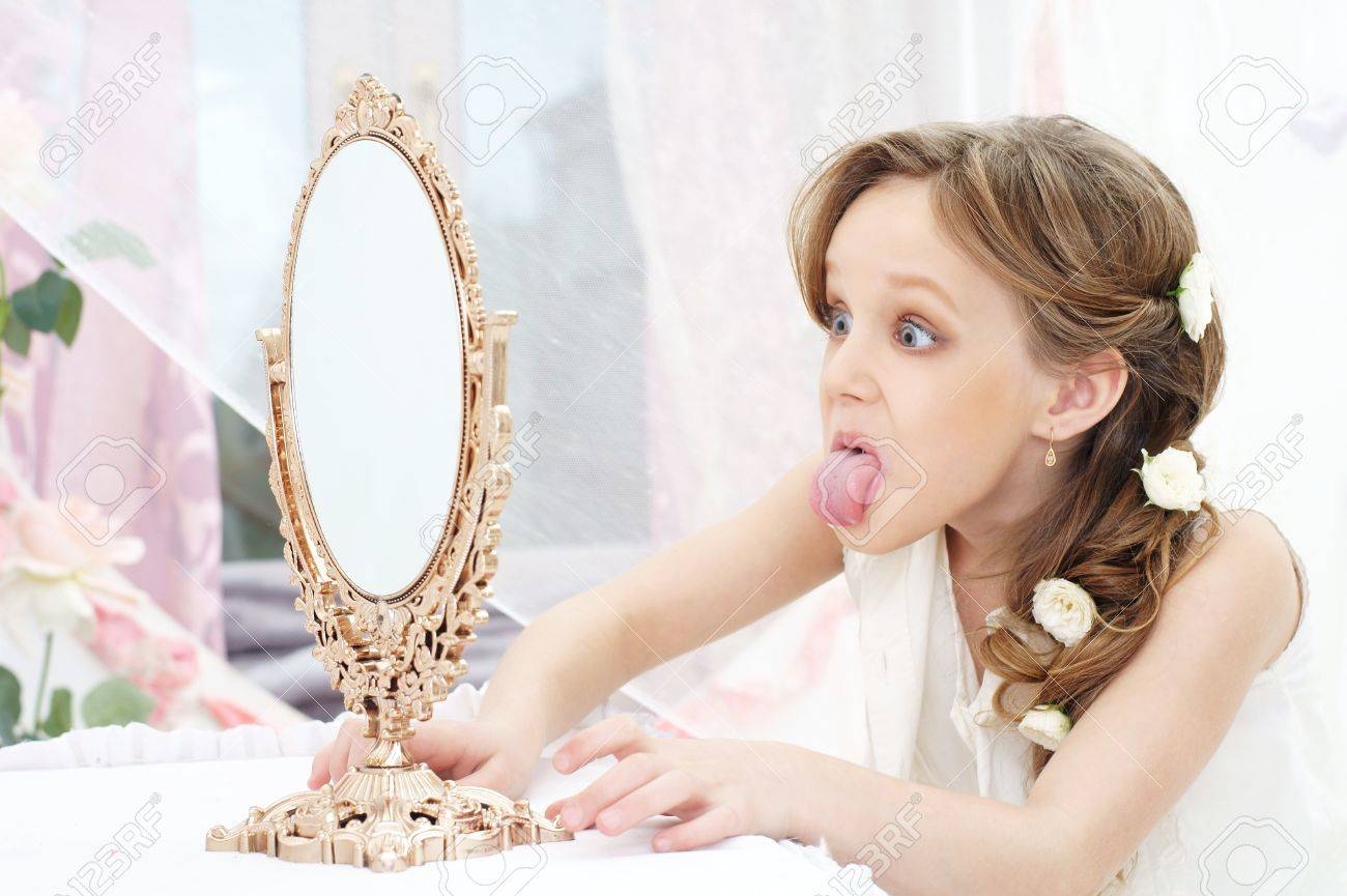 Beautiful Little Girl With Mirror Showing Her Tongue Stock Photo ...