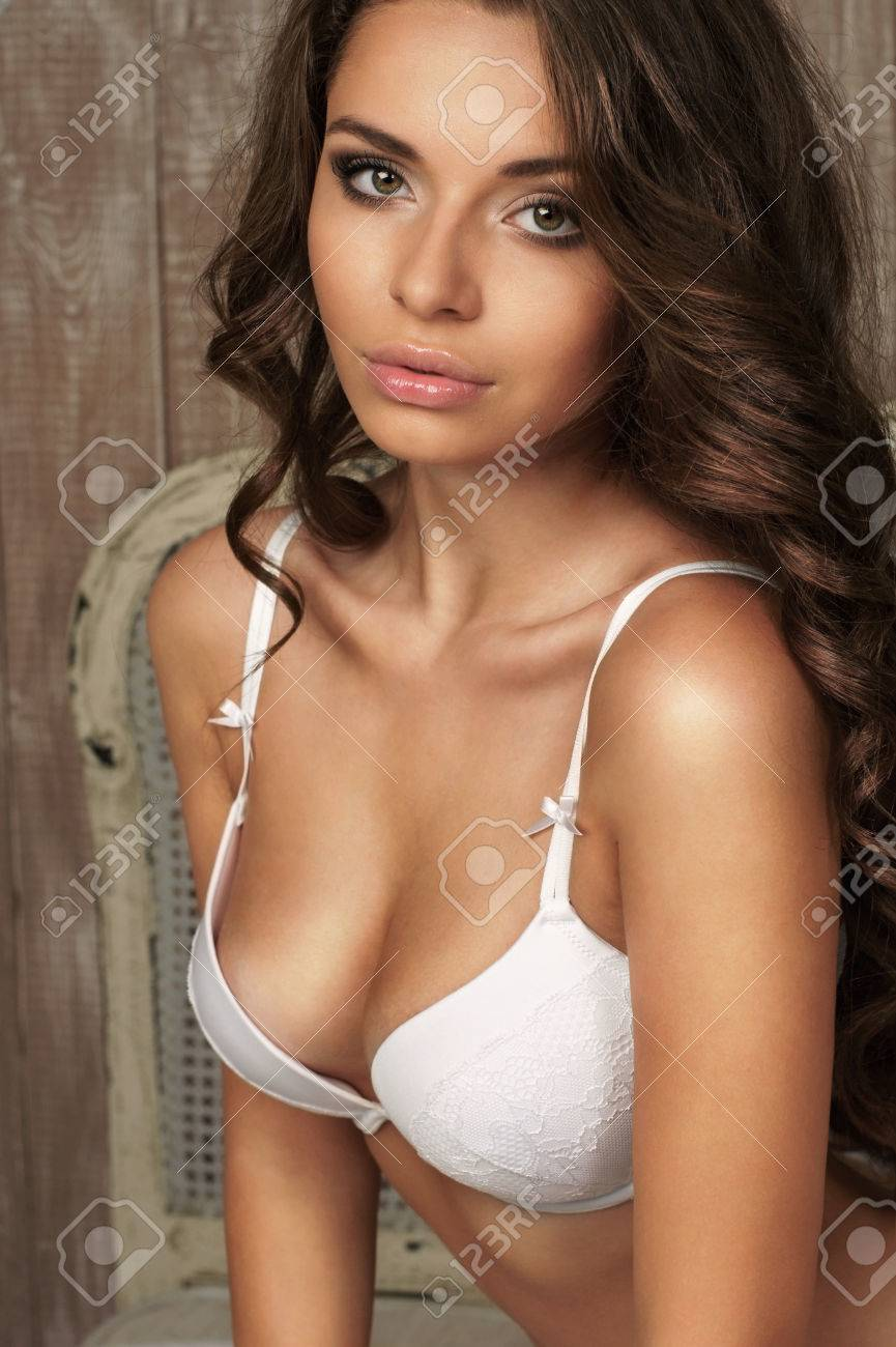 Portrait Of Young Beautiful And Sexy Young Woman In White Bra