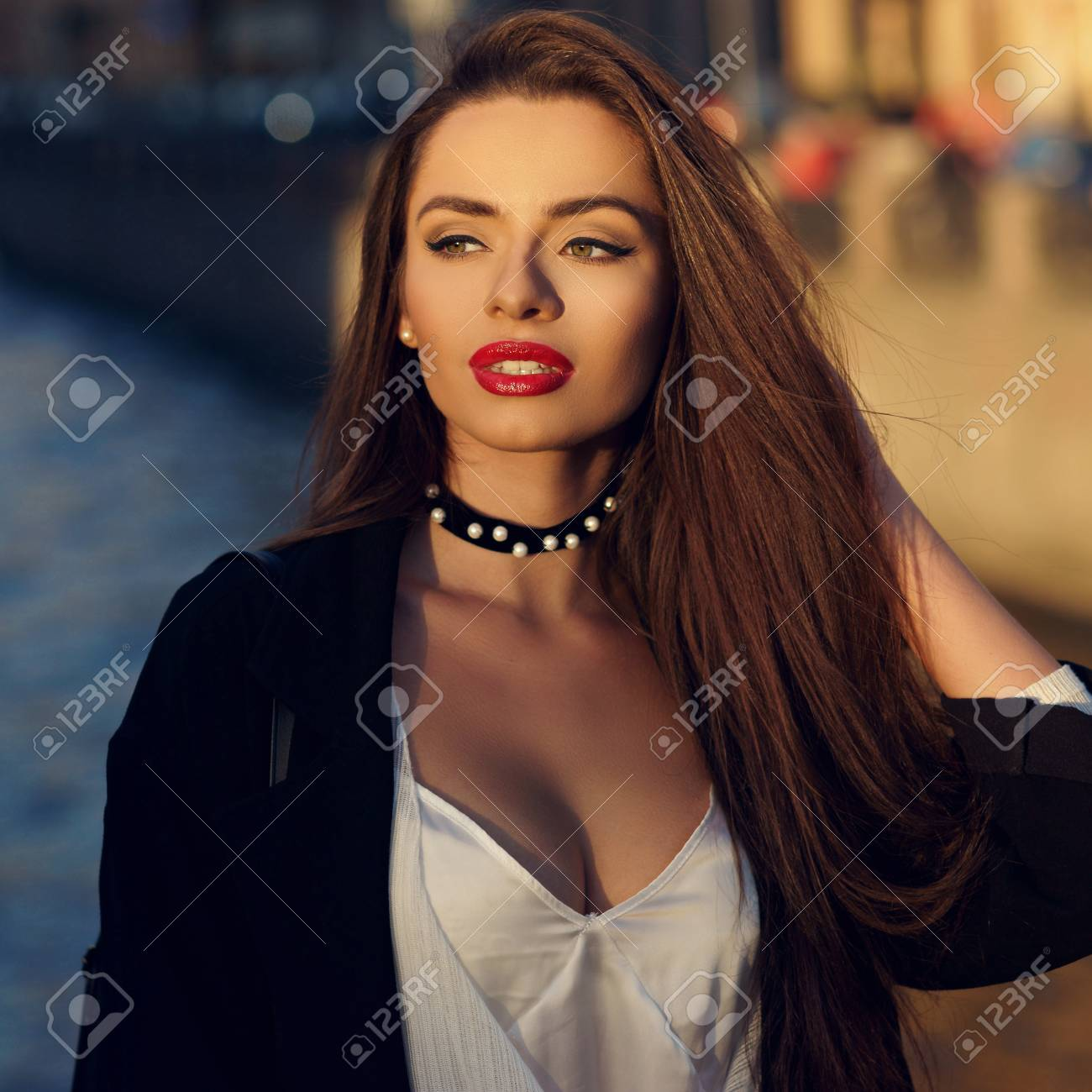 Young Attractive Brunette Woman With Long Hair And Slightly Ajar