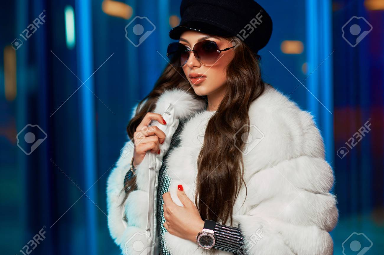 2830c04c0c Stock Photo - Waist up portrait of stylish young woman wearing large round  sunglasses