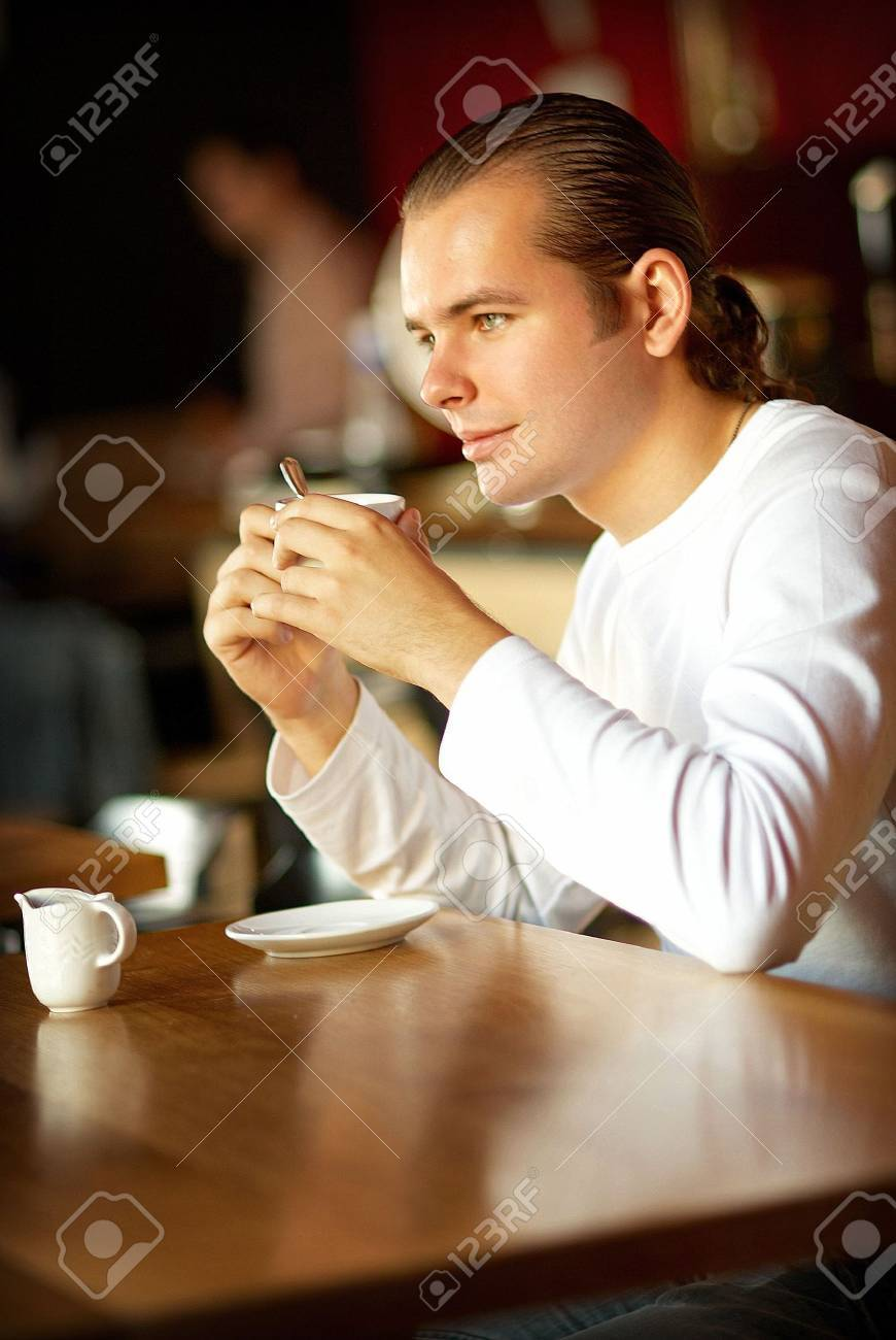 Cup of coffee and young man Stock Photo - 3388659