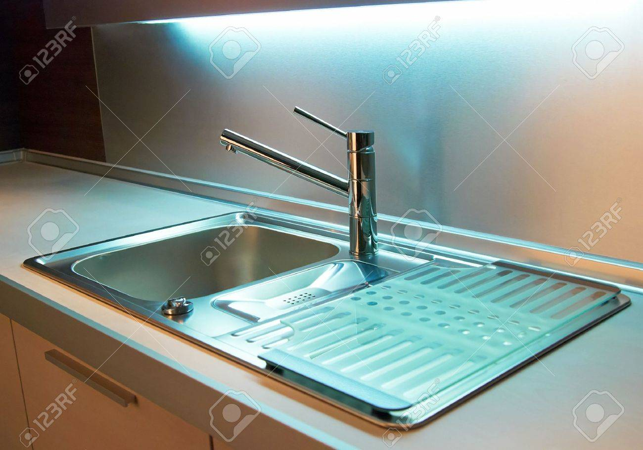 Modern stainless steel tap in white kitchen Stock Photo - 3400866