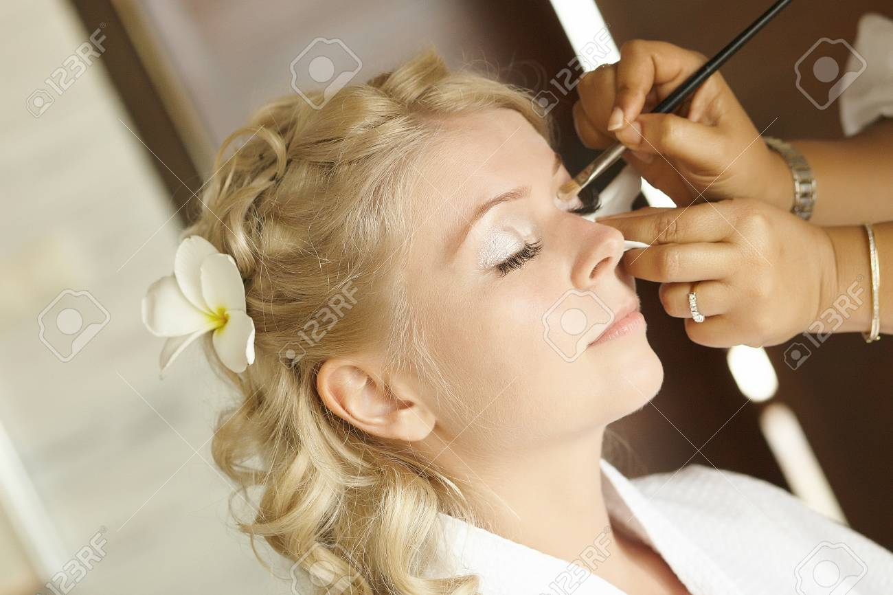 Beautiful Cute Blond Bride Doing Makeup Before Wedding Day Stock