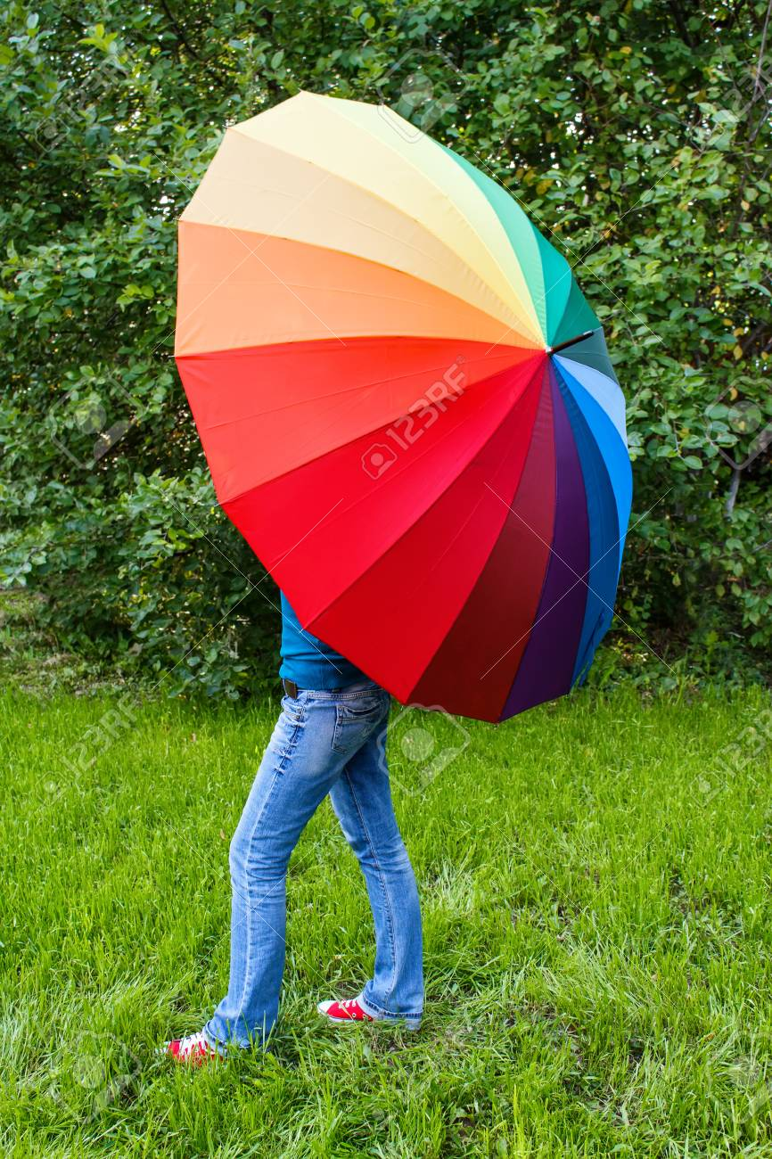 Woman Holding Colorful Umbrella Outdoors Stock Photo, Picture And ...