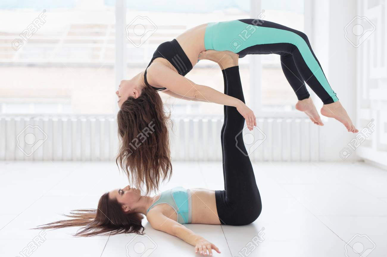 Group Of Two Fit Women Practicing Balance Yoga Pose Acroyoga Stock Photo Picture And Royalty Free Image Image 95571499 Pobierz to zdjęcie group of three sportive fit women pose at studio on grey teraz. group of two fit women practicing balance yoga pose acroyoga