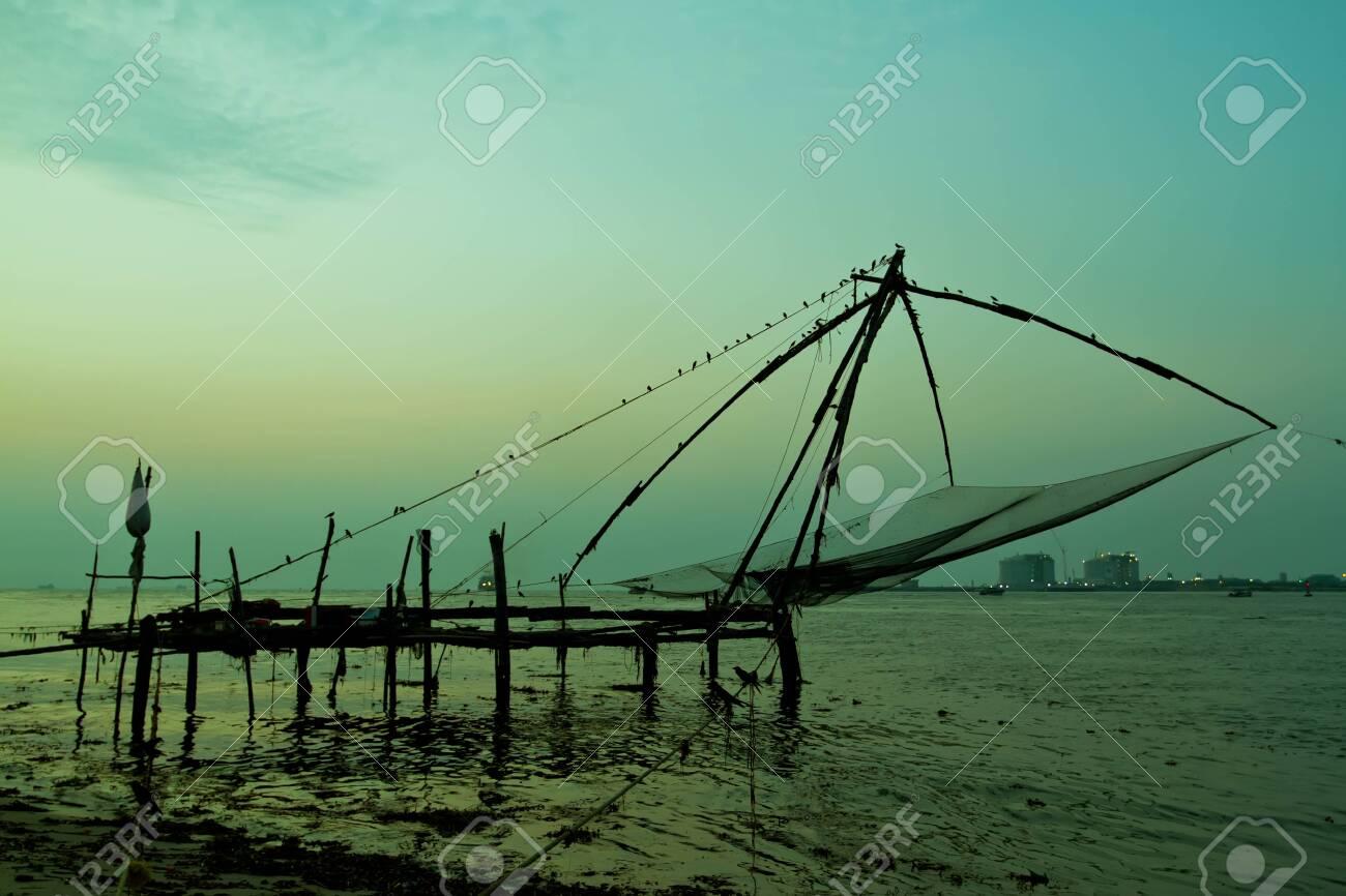 Chinese fishing net at sunset in Cochin, Fort Kochi, Kerala, India - 144795933