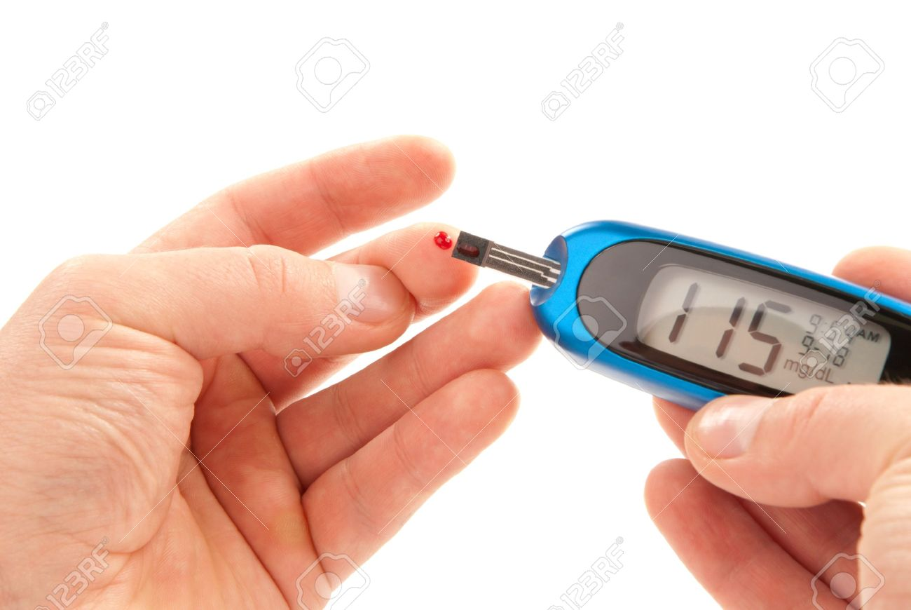 Diabetic patient doing glucose level blood test using ultra mini glucometer  and small drop of blood