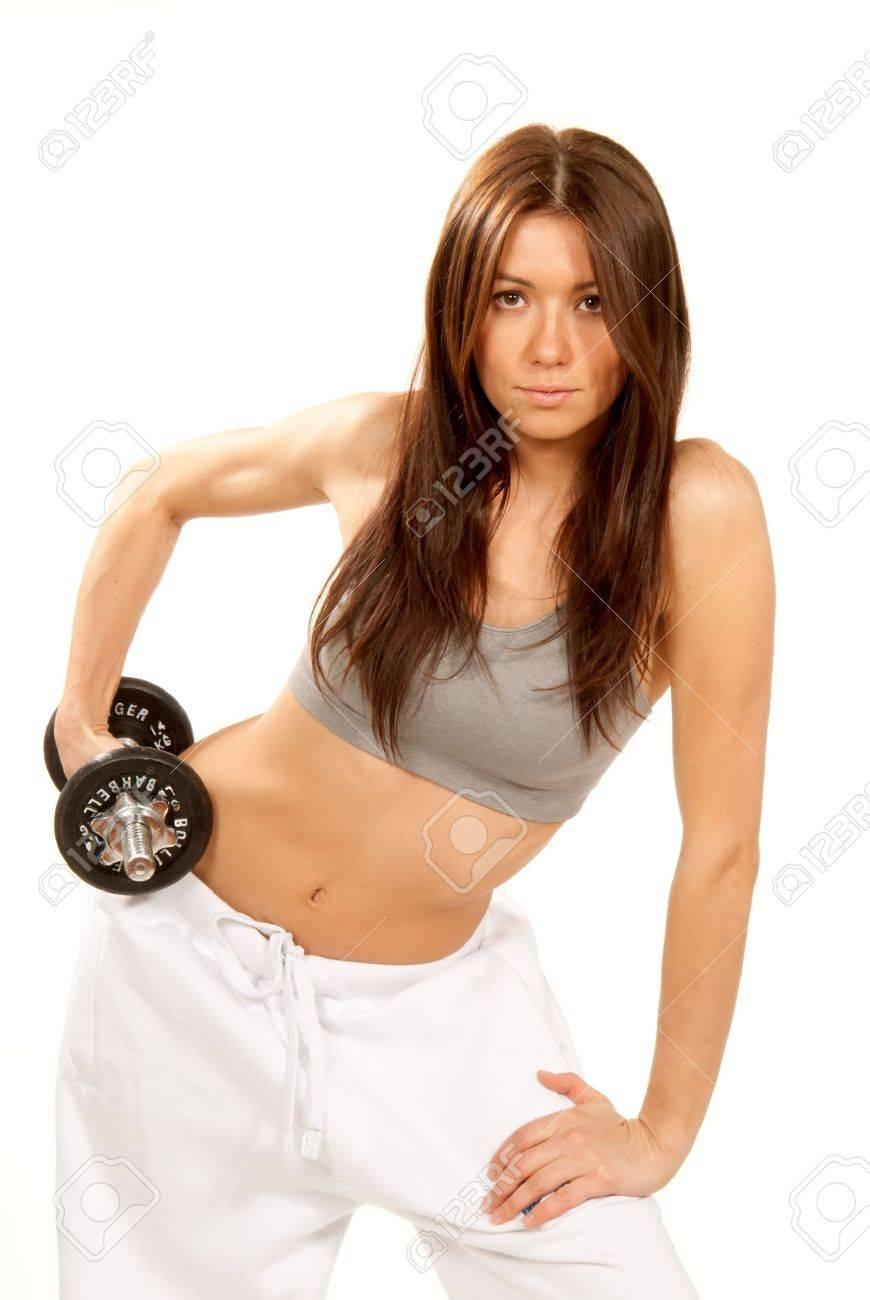 Mujer bonita de Fitness con cuerpo atlético, levantamiento de pesas de pesos aislado en un fondo blanco Foto de archivo - 8790889