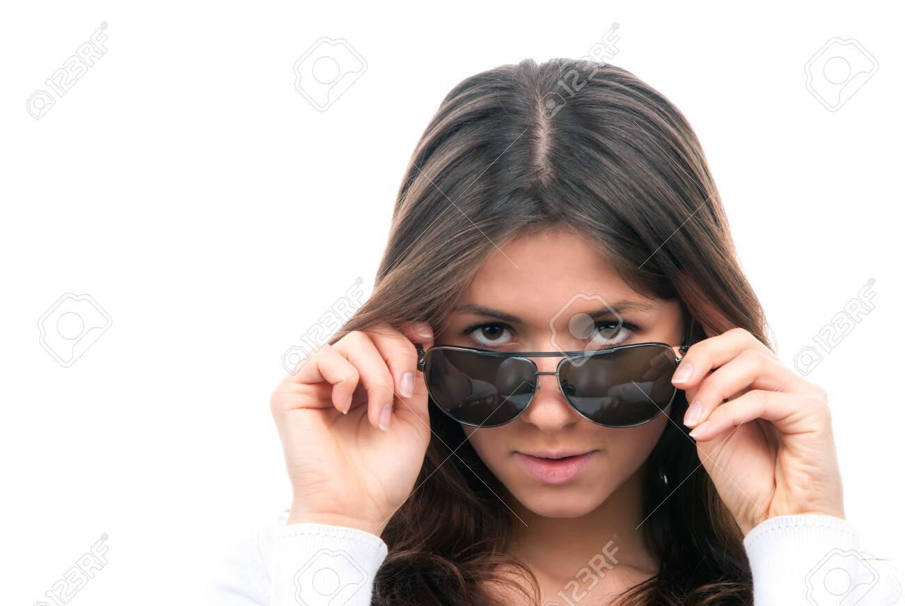 Beautiful fashion woman wearing off sunglasses isolated on a white background Stock Photo - 8992056