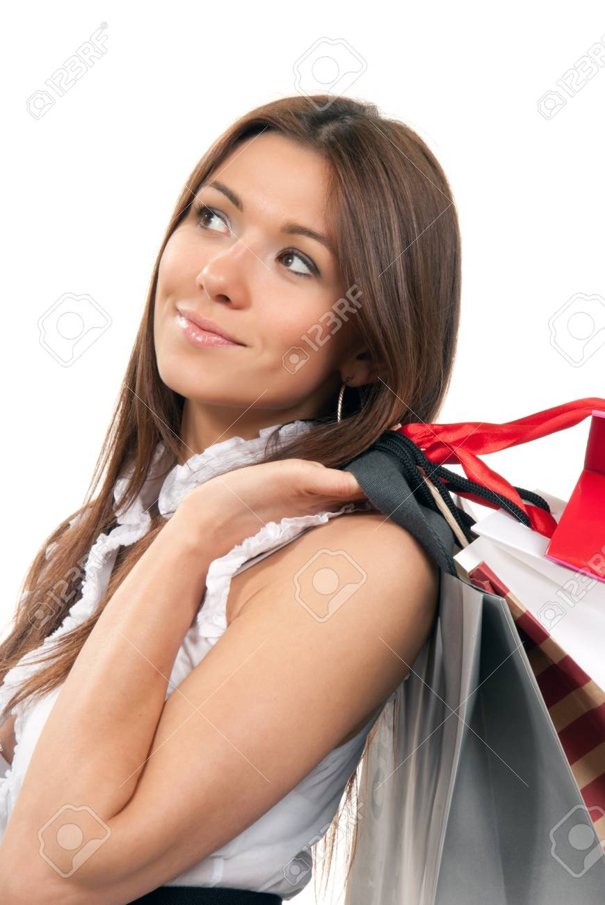 Young pretty woman holding colorful shopping gift bags on the shoulder smiling and cheerful thinking over white background Stock Photo - 9137811