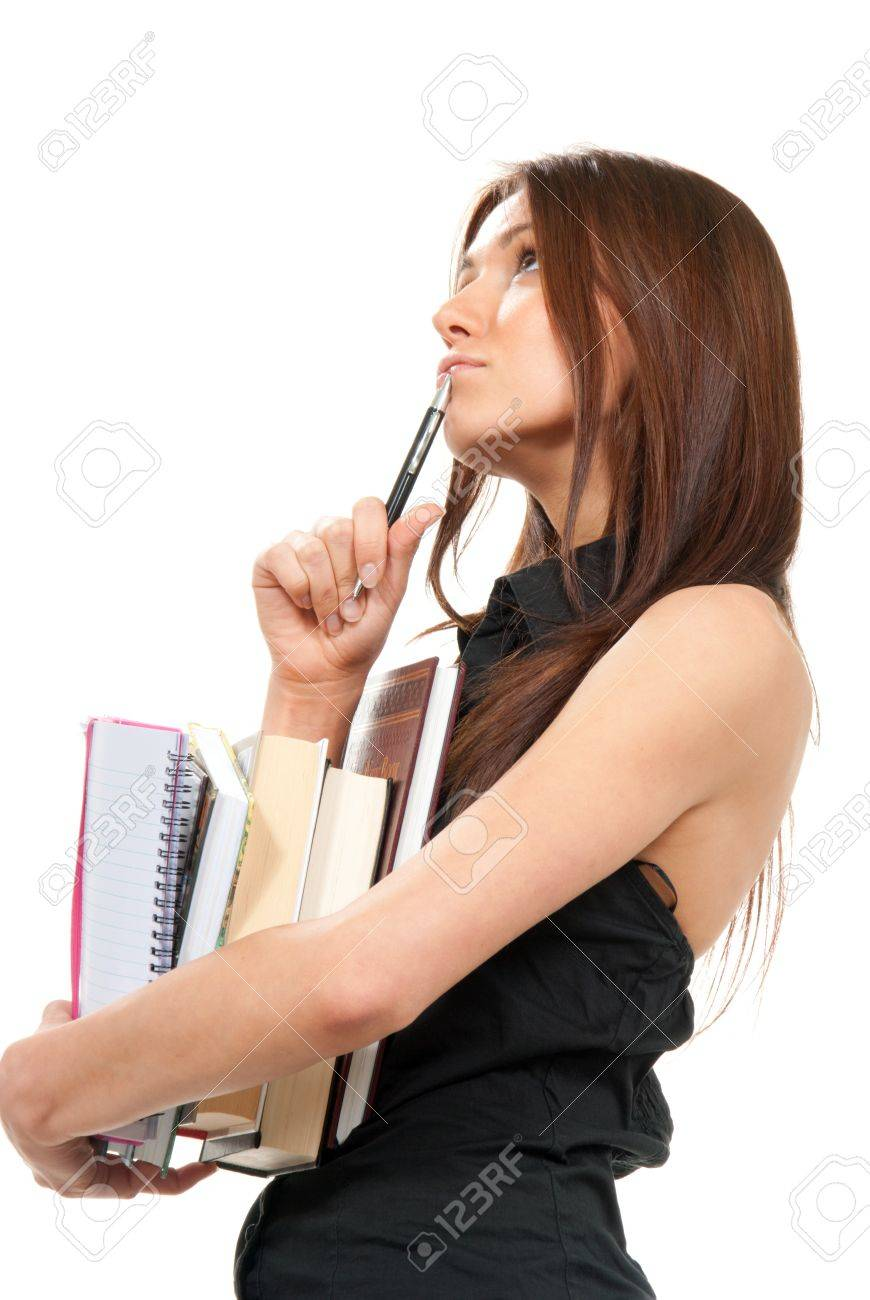 Pretty School girl thinking, holding stack of books, notebook, copy-book and a pen near the head ready for college classes on a white background Stock Photo - 9524435
