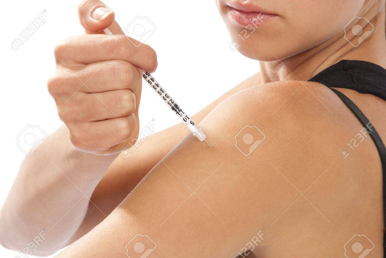 Diabetes dependent woman making insulin flu shot by syringe with dose of humalog, subcutaneous arm injection vaccination isolated on a white background Stock Photo - 10372621