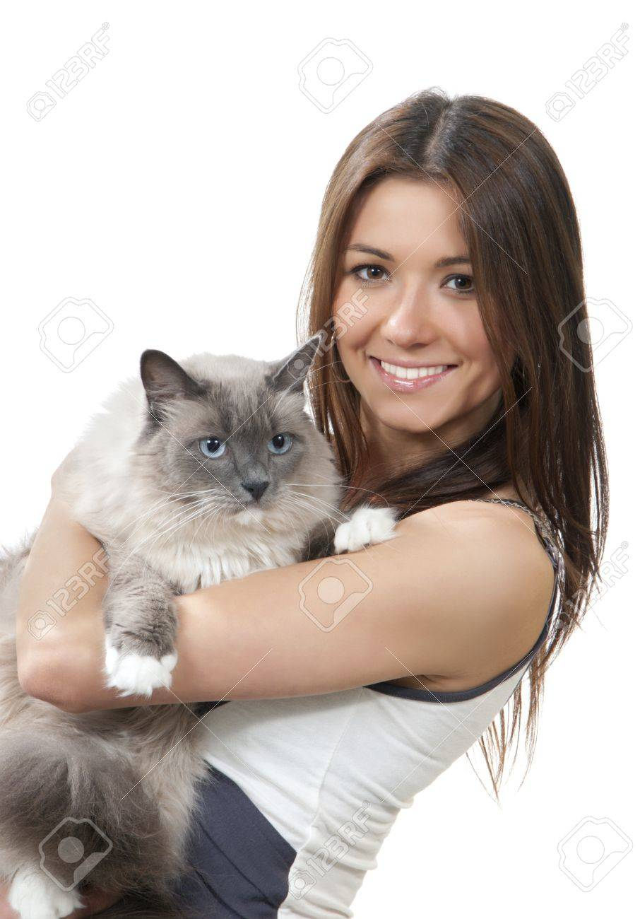 Young pretty woman hold her lovely Ragdoll cat with blue eye isolated on a white background Stock Photo - 10423596