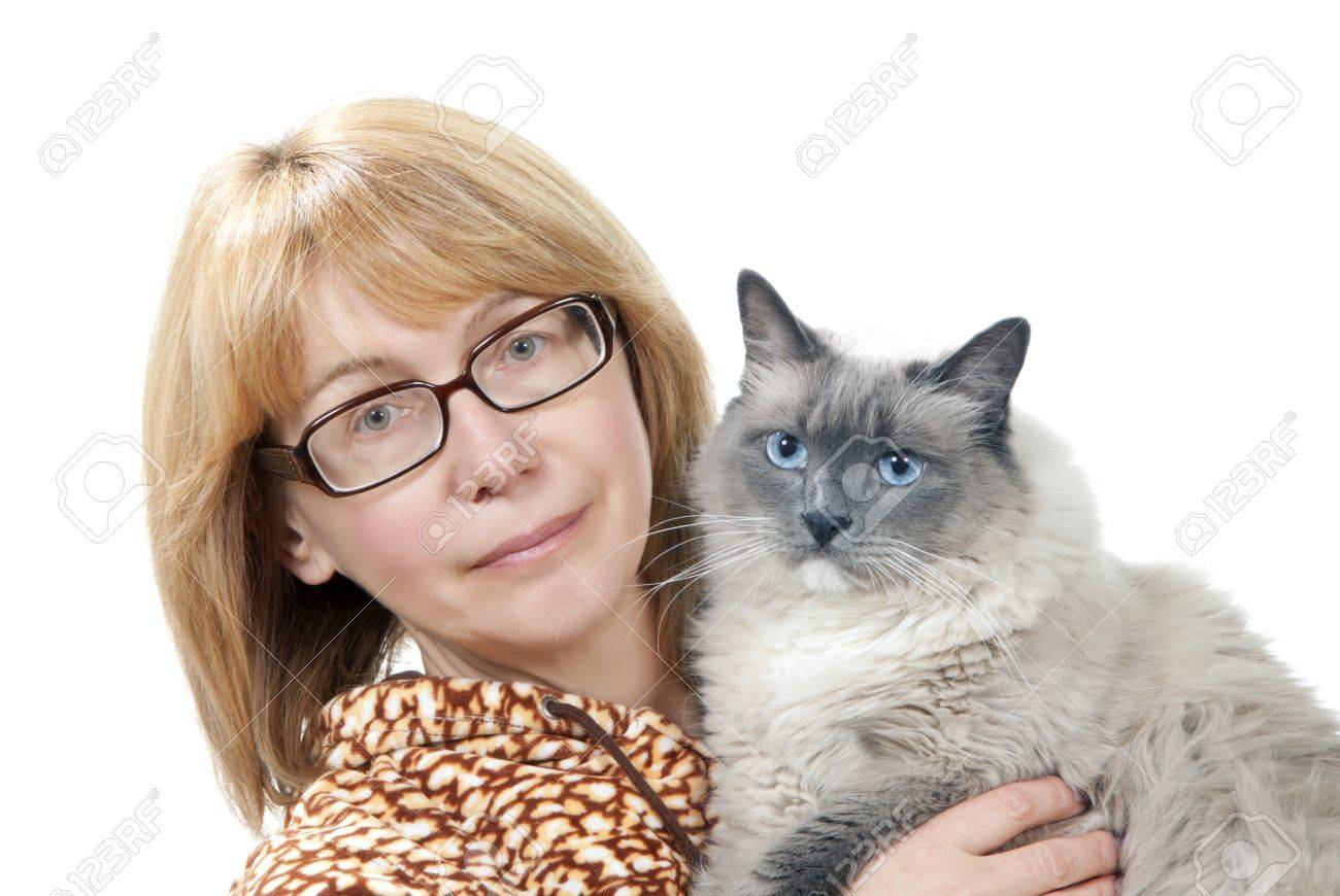 Woman hold her lovely Ragdoll cat with blue eye isolated on a white background Stock Photo - 10423597