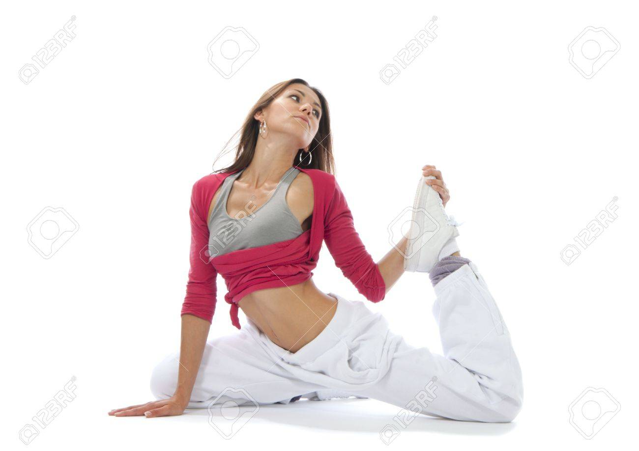 Pretty flexible dancer woman sit on half twine and stretching on a white background Stock Photo - 10423601