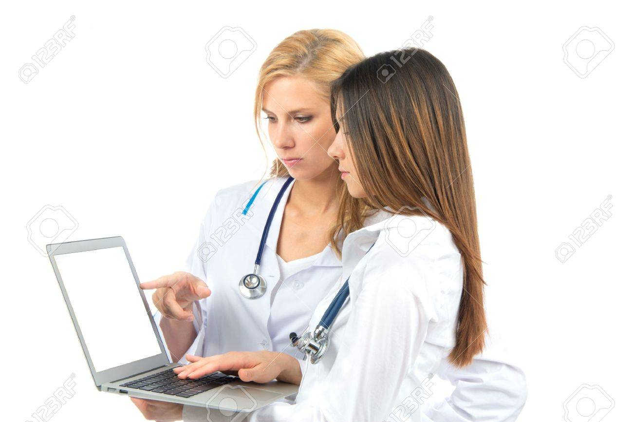 Two woman doctor and nurse research and hold laptop computer in hands finger pointing digital screen isolated on a white background Stock Photo - 12118134