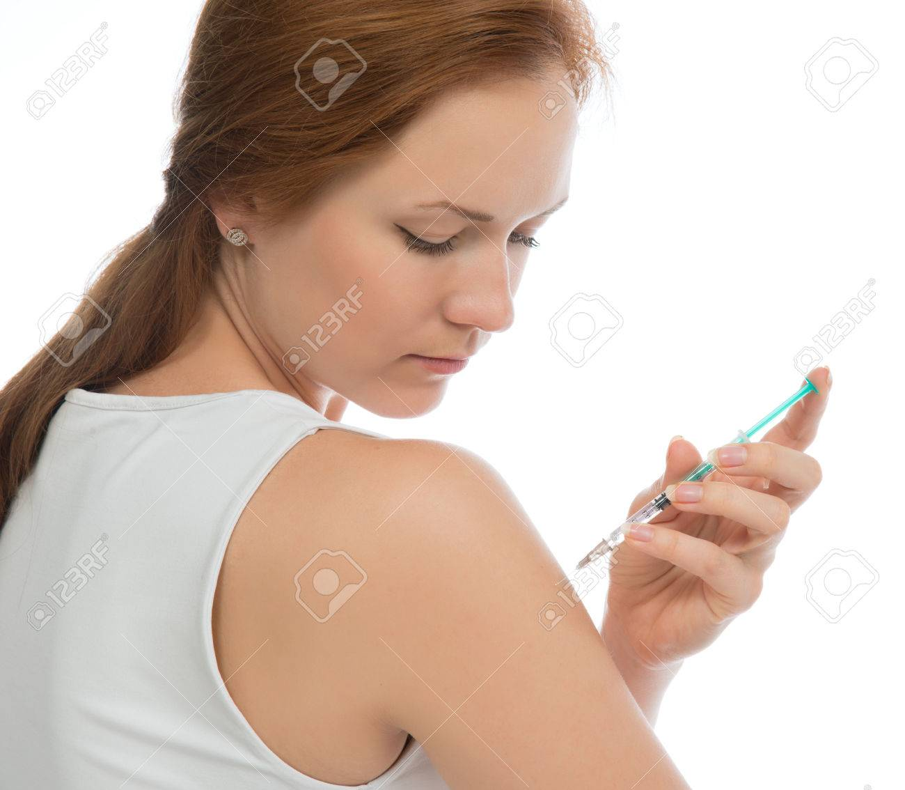 Diabetes woman patient make an arm subcutaneous insulin syringe injection vaccination shot at home on white - 29083517