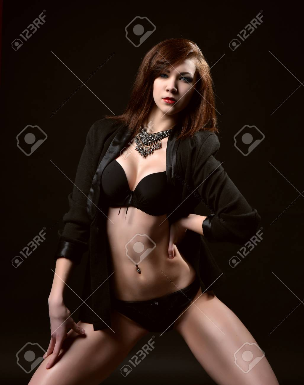 8697d4a410c Young sexy beautiful woman in black lingerie in dark background Stock Photo  - 40226686