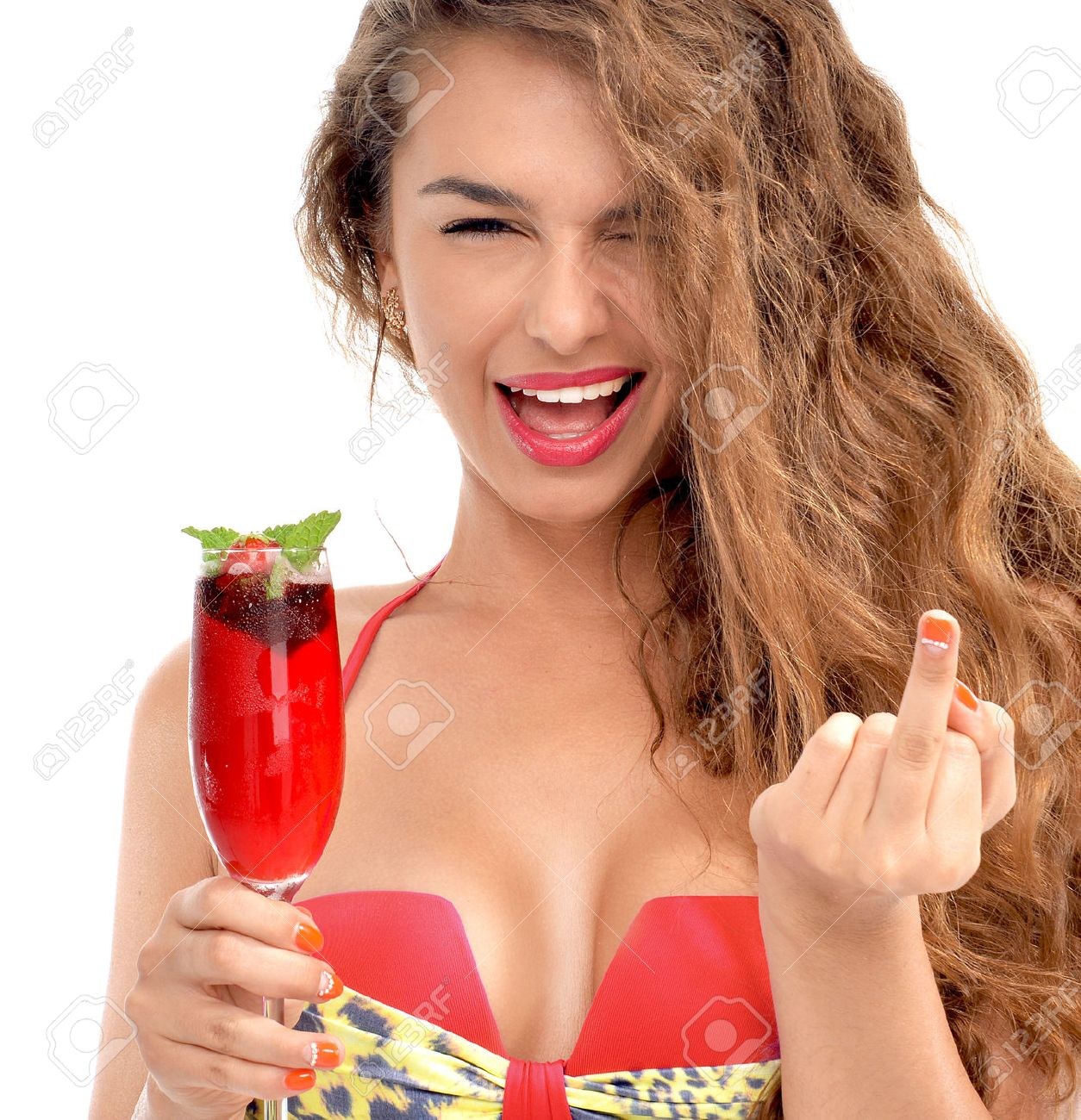 Young beautiful woman in bikini hold margarita cocktail juice and show middle finger you off sign isolated on a white background - 52311135