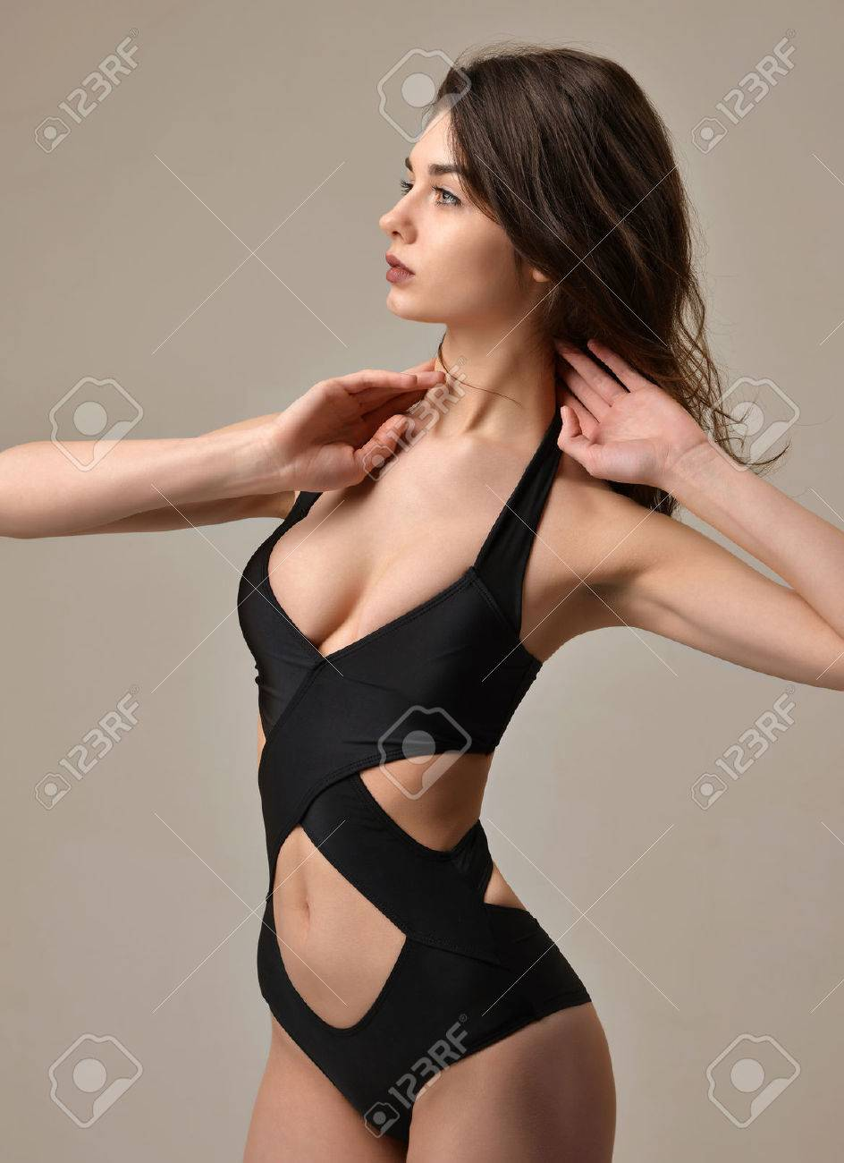 Sexy young beautiful woman posing in black modern underwear vest looking at  the corner on a 145bc52a2