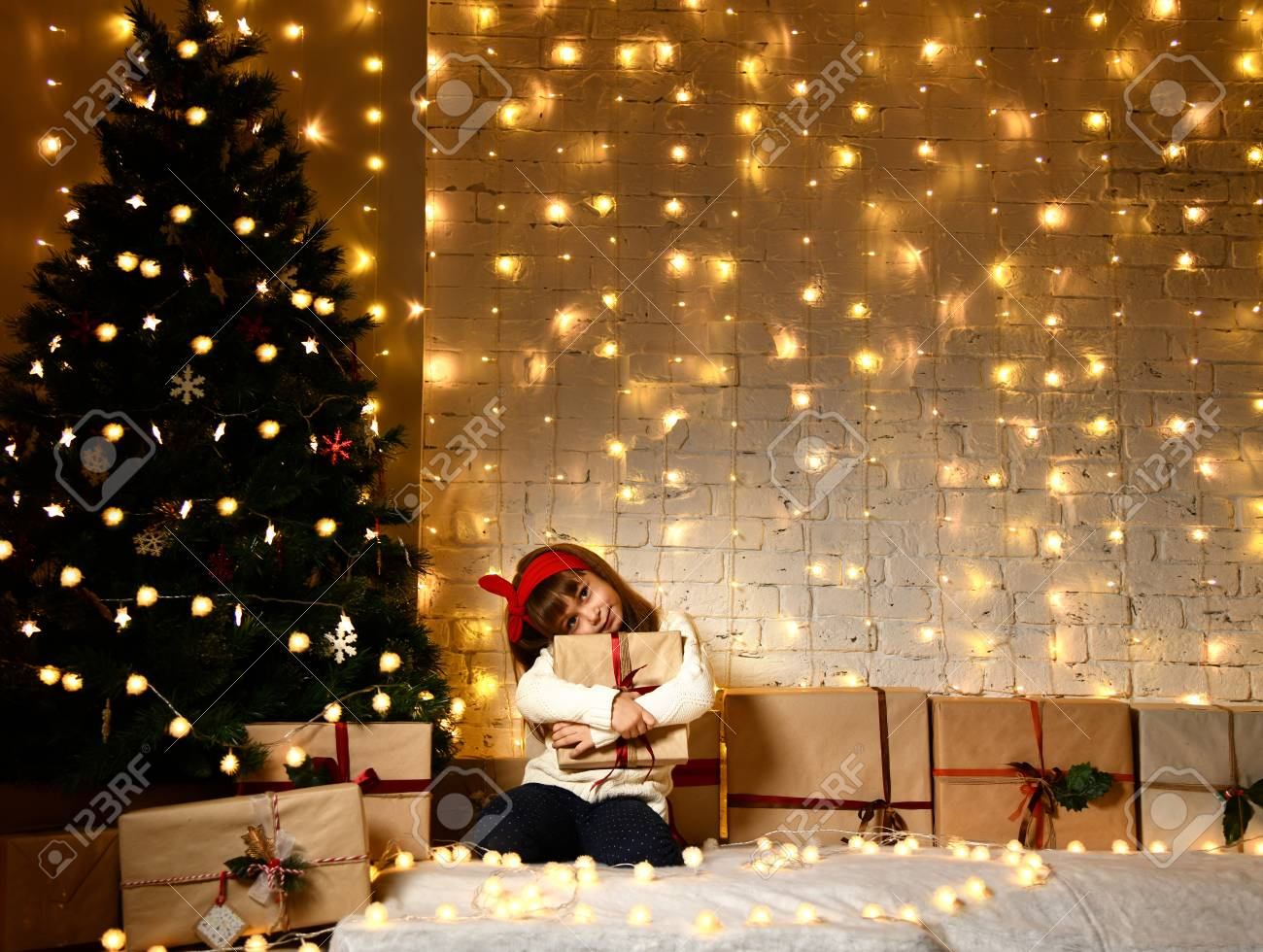 Asian Child Baby Girl Kid Sitting Under Decorated Gold Christmas