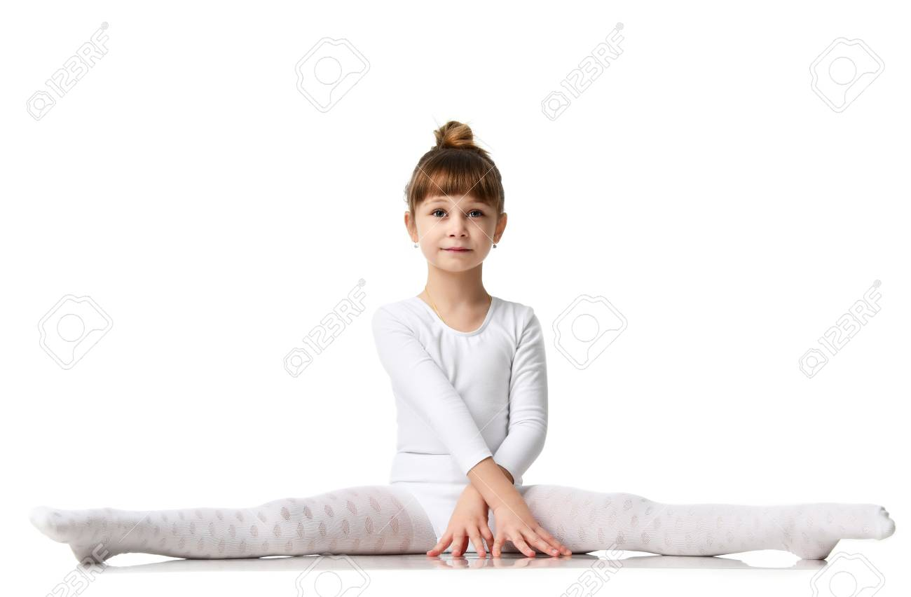 Young sport brunette girl do splits workout stretching exercises