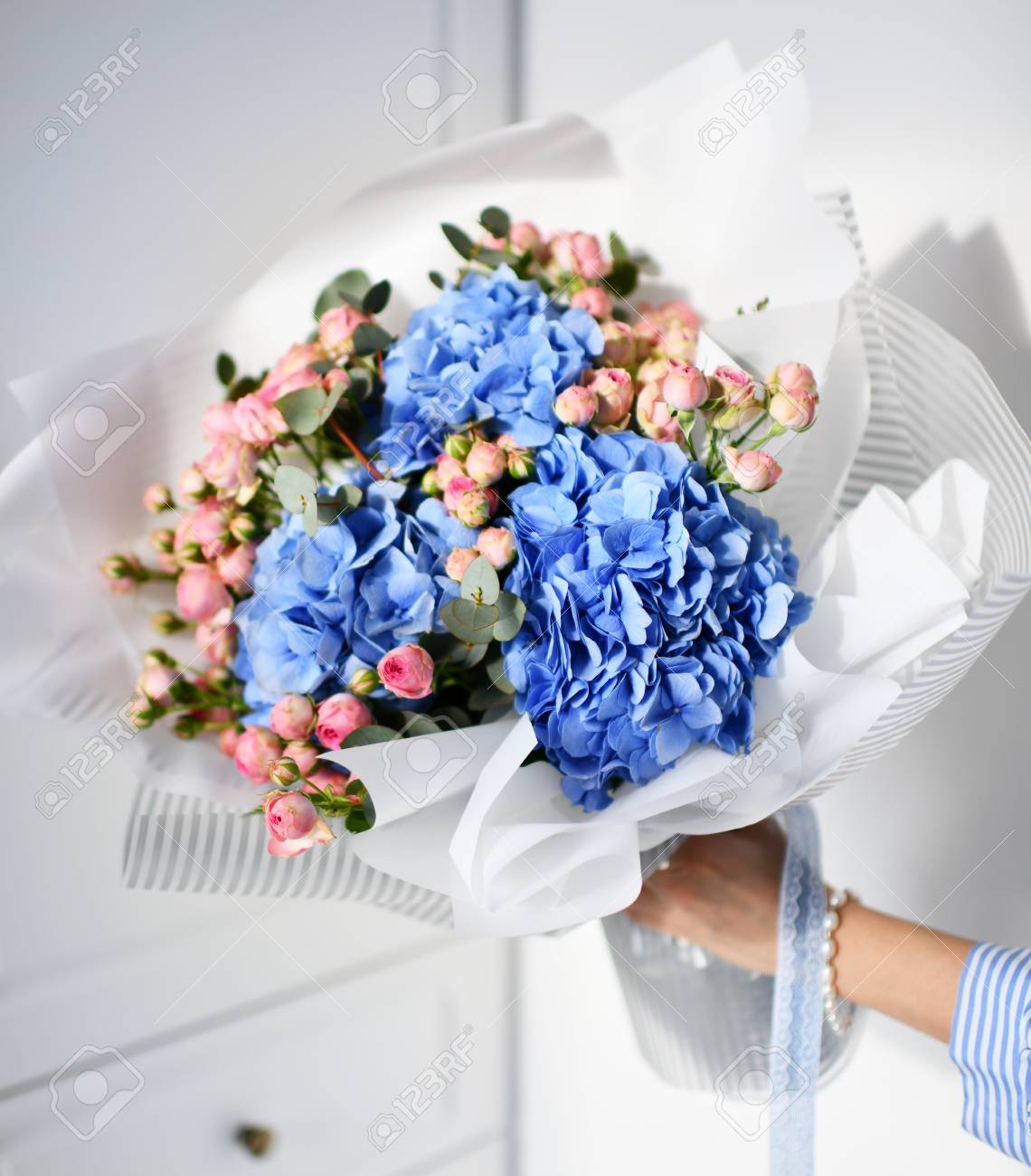 Woman Hand Hold Bouquet Of Blue Hydrangea Flowers And Pink Roses Stock Photo Picture And Royalty Free Image Image 101183518