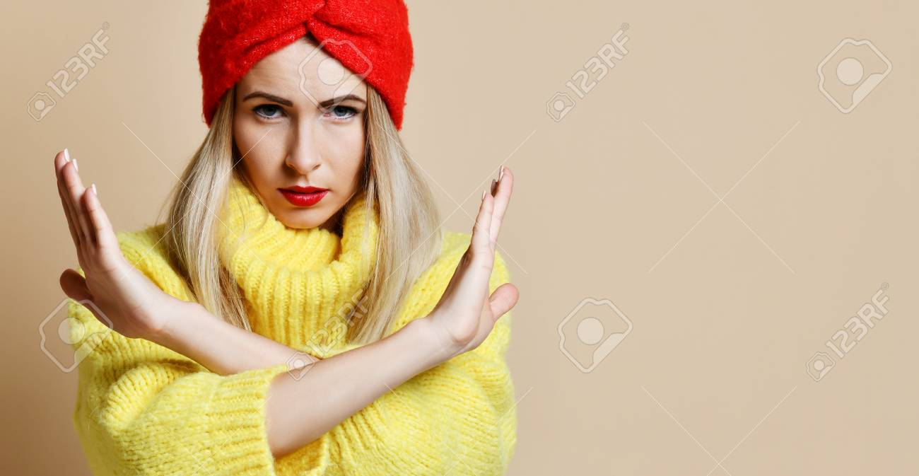 Woman Shows No Sign With Cross Hands Stop Gesture In Yellow Sweater